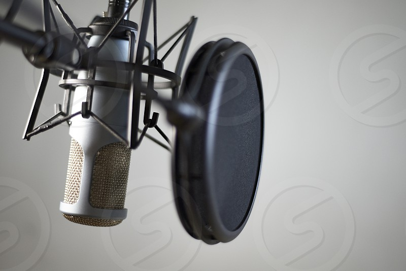 Close up of studio microphone shot in a studio on a white background photo