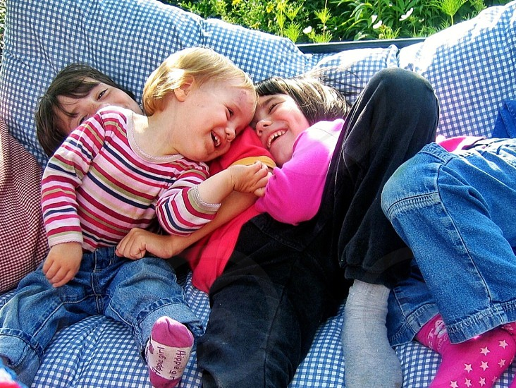 3 girls sitting smilling photo