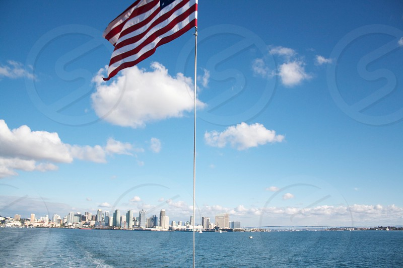 U.S.A flag under blue sky under white clouds during daytime photo