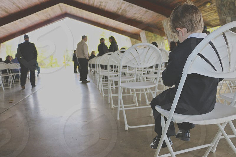 little man awaiting his place in the ceremony photo
