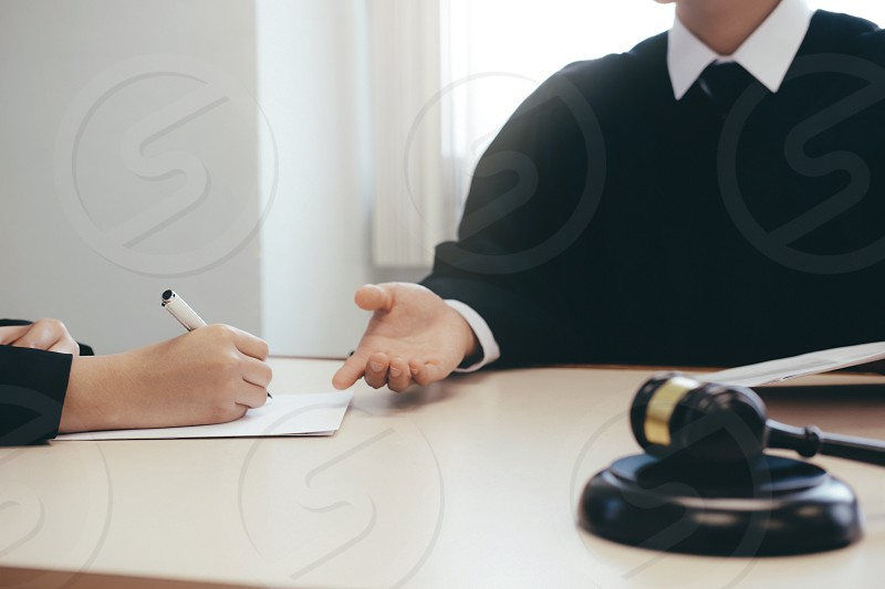 Law advice and Legal services concept. Lawyer and attorney having team meeting at law firm. photo