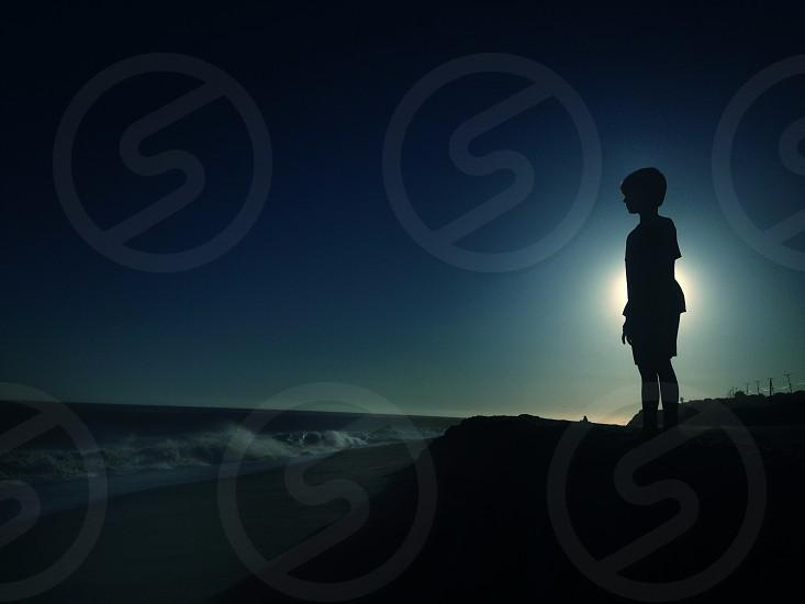 boy's silhouette photo