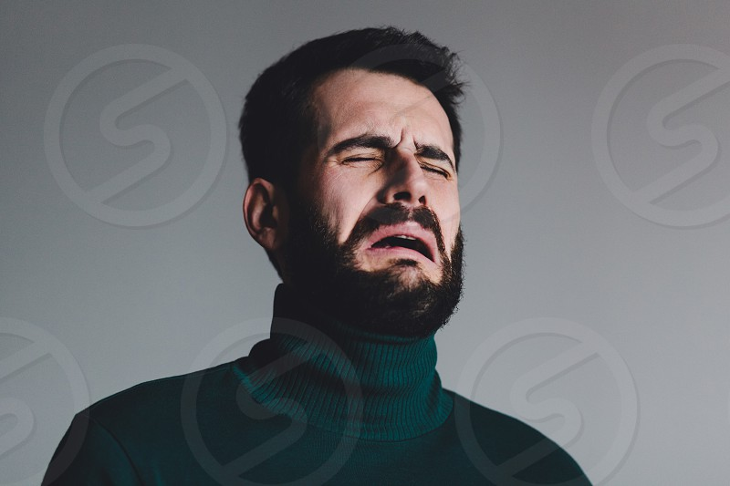 Young man with a problem crying photo