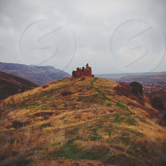 ruined building on a hill photo