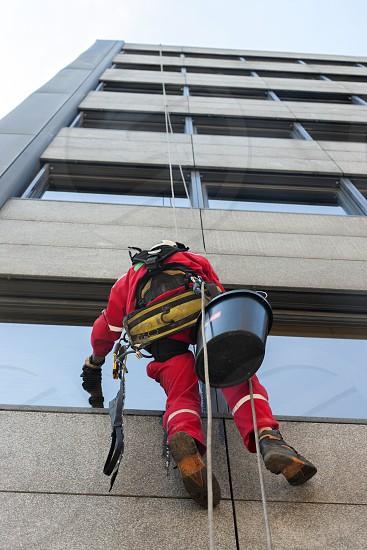 High altitude alpinist window washer photo