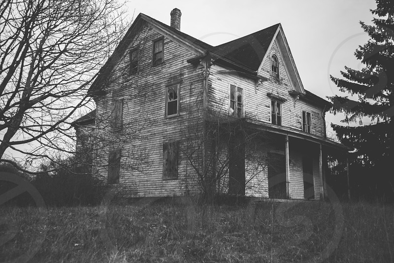 grayscale photo of 3 storey house during daytime photo
