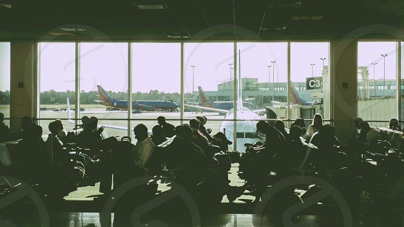 people in airport waiting station photo