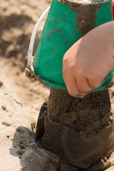 Building sand castles bucket and sand photo