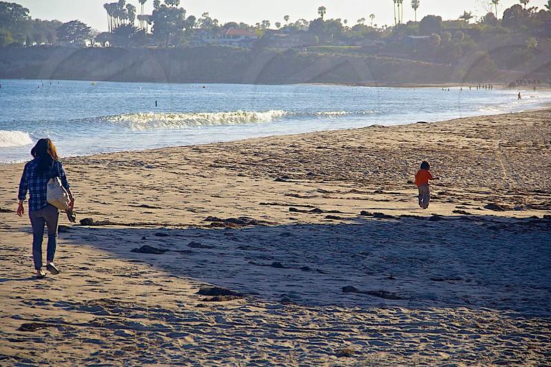 Sunset beach walks with a little one makes it an adventure photo