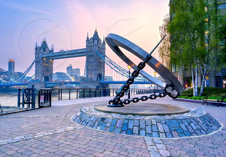 London United Kingdom - April 17 2019 : View of Tower Bridge on the River Thames with the sundial titled Timepiece that was designed by Wendy Taylor in 1973. photo