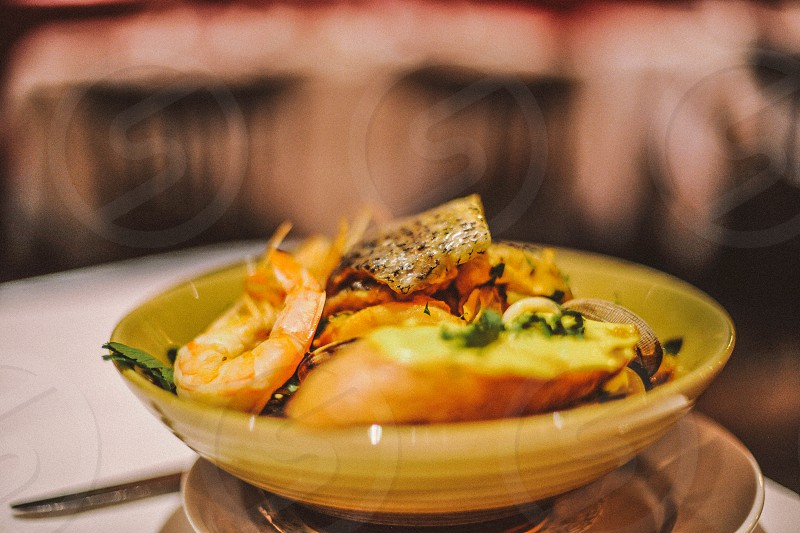 steamed shrimp with bread in a yellow ceramic bowl photo