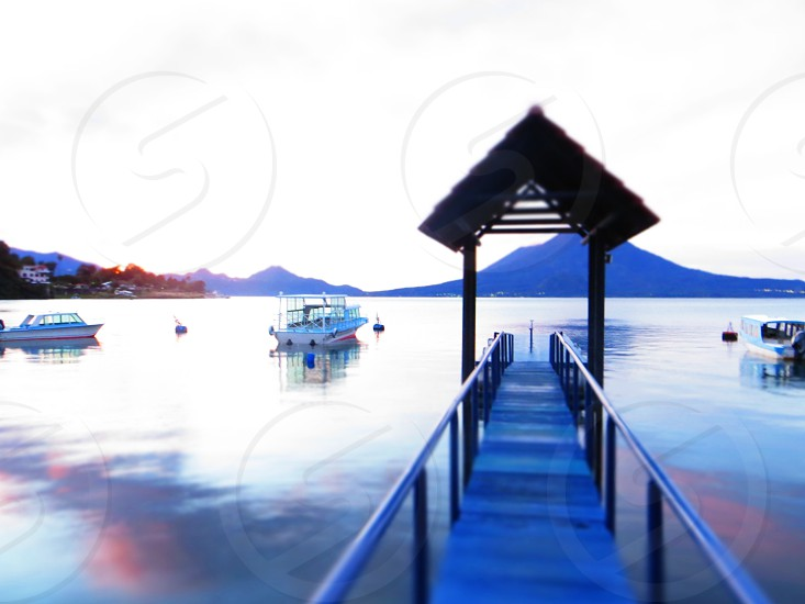 Boats on Lake Atitlan Guatemala. Dock; sunrise. photo
