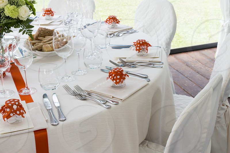 Restaurant with tables set for a wedding reception photo