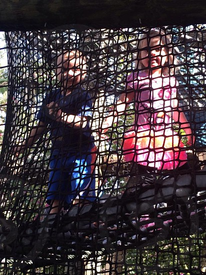 boy and girl playing on net photo