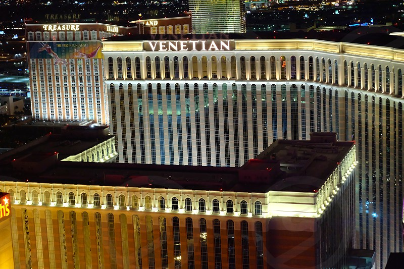 The Venetian hotel light up at night from above.  photo