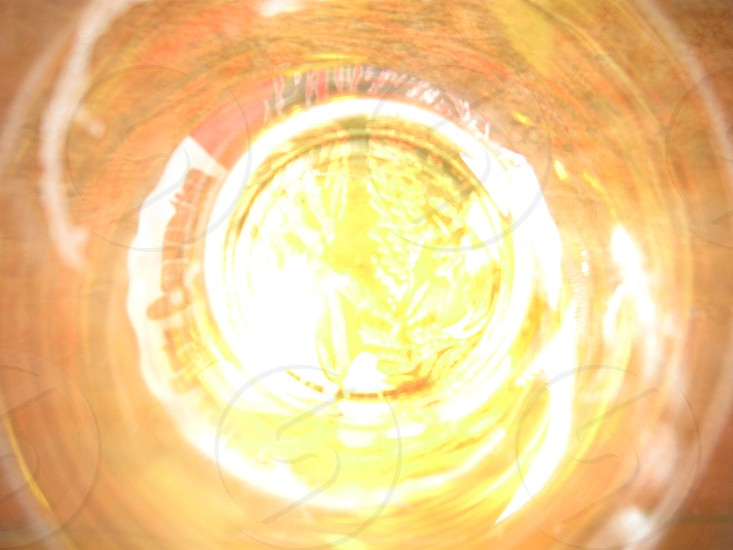 Shot Glass bottom of a shot glass with whisky whiskey photo