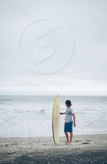 man holding surfing board photo