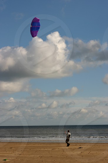 Kite flying on Swansea Beach Wales. photo