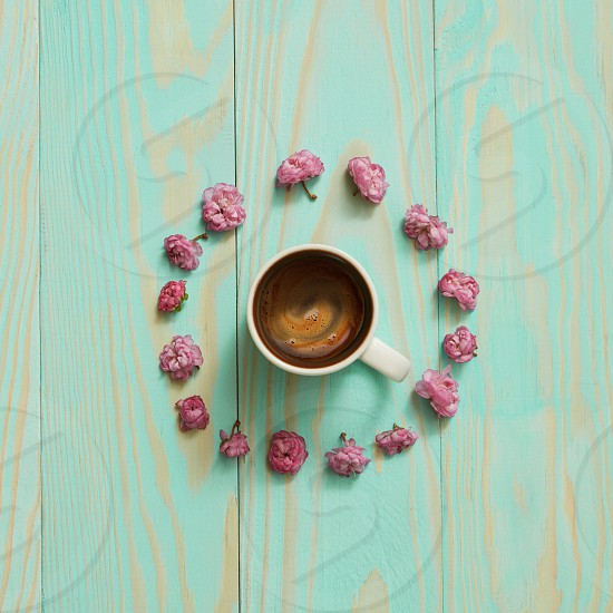 Creative flat lay morning coffee in flower shape. photo