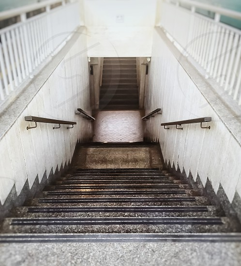 perspective view of a staircase with iron handrail and with a white balustrade photo