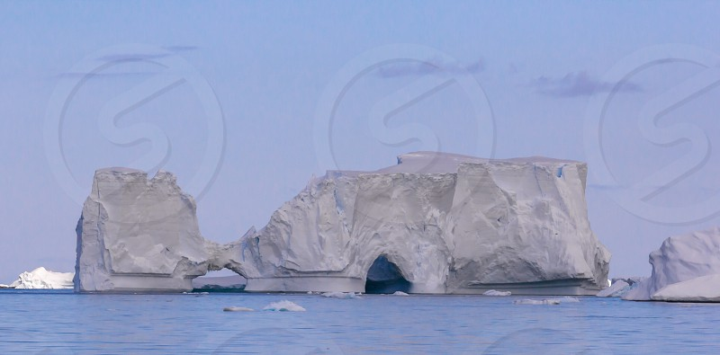 Iceberg Antarctica ocean water peltier channel global warming climate change sailing expedition iceberg arch photo