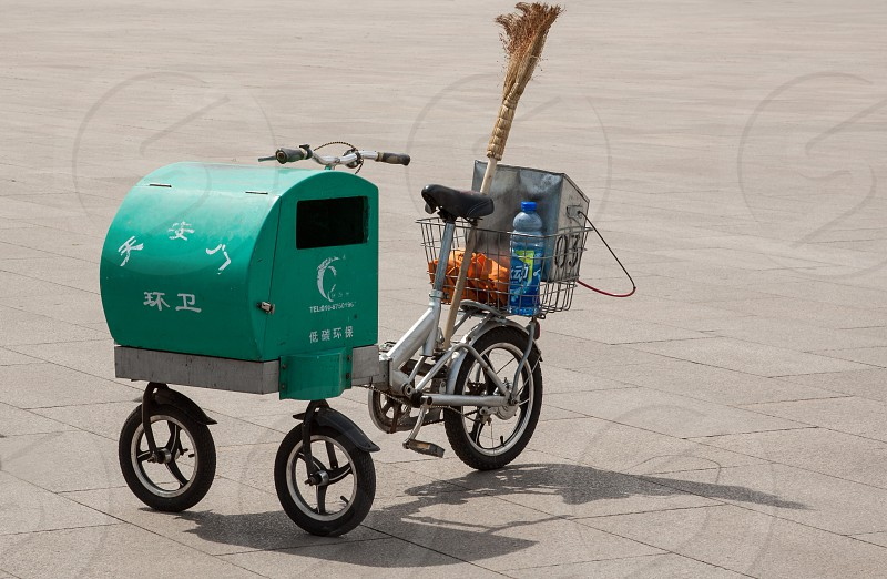 Maintenance worker tricycle at Tiananmen square photo