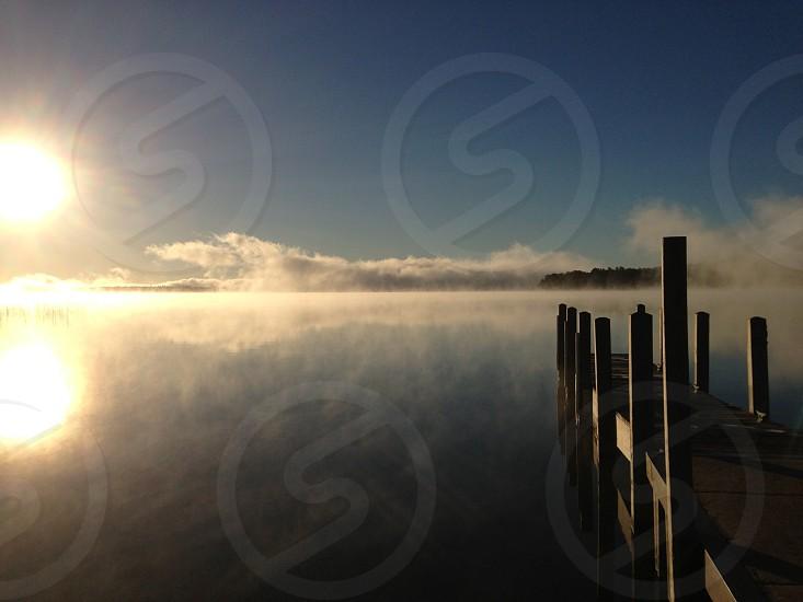 Sunrise over a misty lake photo