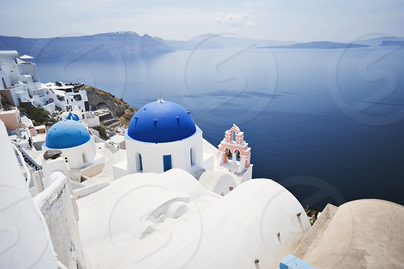 Gorgeous scenery of the blue domes Oia photo