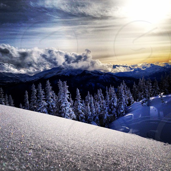 Light reflecting off of snow on the mountain in Whistler British Columbia Canada and sunset photo