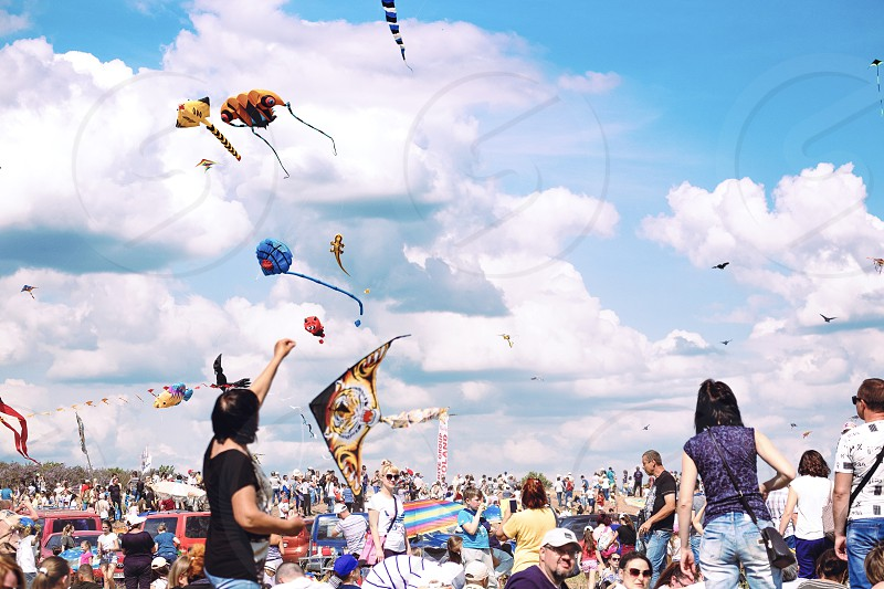 leisure activity cloudy sky feel freedom festival colorful crowds of people beautiful sky blue sky kites kite flying summer lifestyle photo
