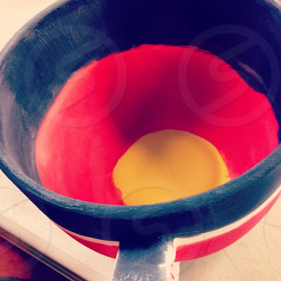 Painting pottery before baking in the oven. Made a German flag themed cup in celebration for the 2014 World Cup. photo