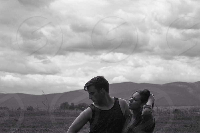 grayscale couple standing photo