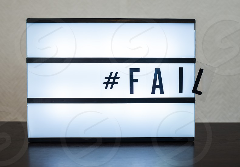 Text Fail and hashtag. Concept for error and falling. Illuminated message. photo