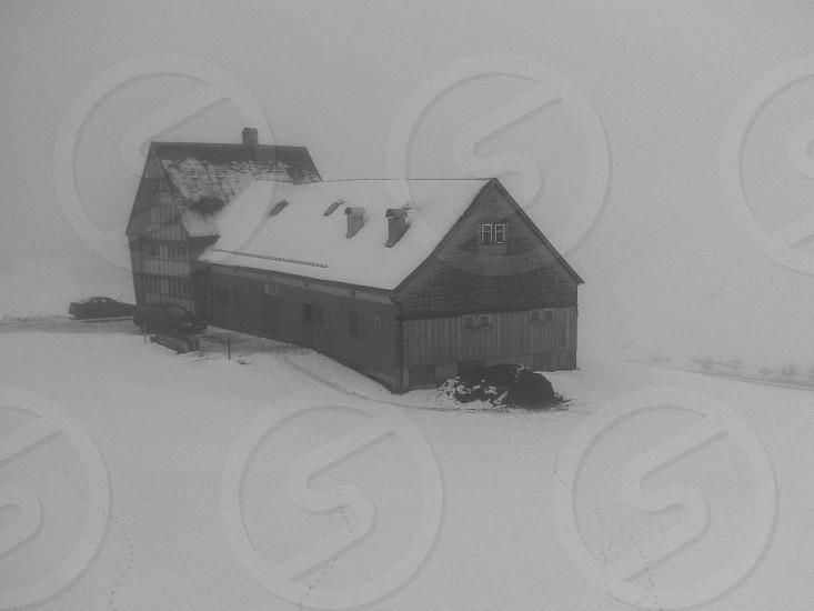barn house snow b&w photo