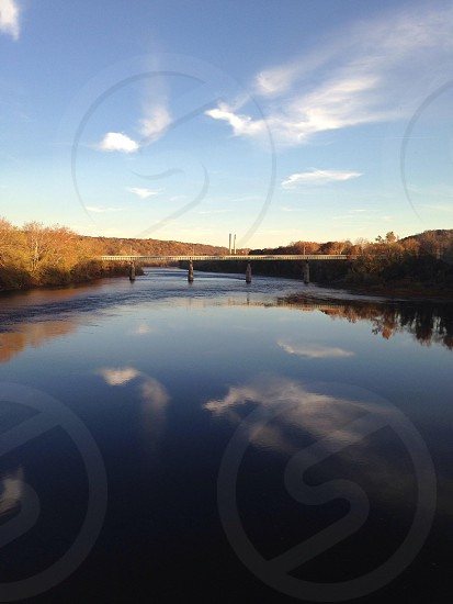 Reflections of the clouds in the Delaware River in NJ photo