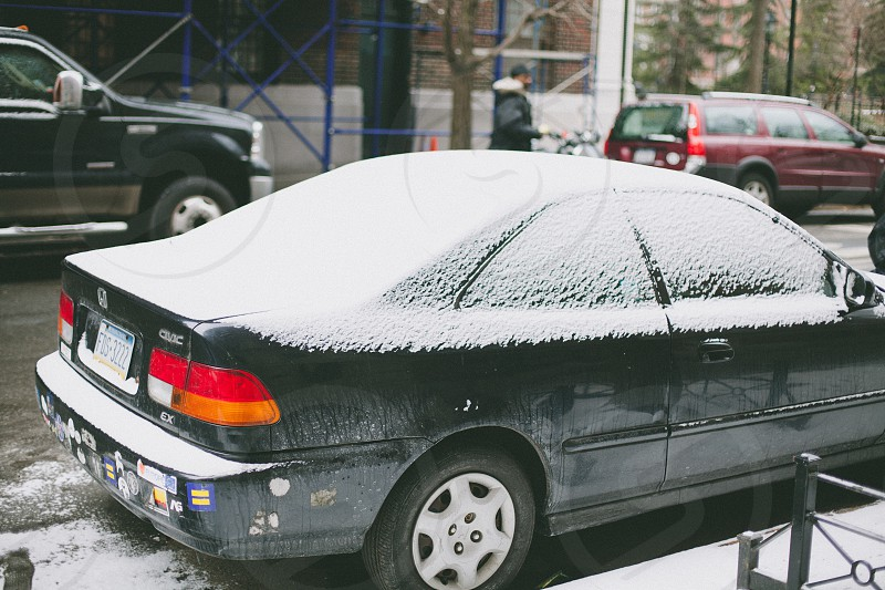 black honda civic covered with snow photo