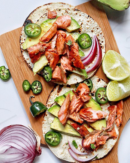Soy glazed salmon tacos with jalapenos avocado and lime juice photo