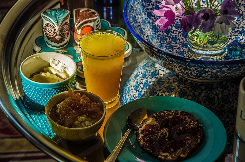An early-morning breakfast with eggs yogurt oatmeal and orange juice. photo