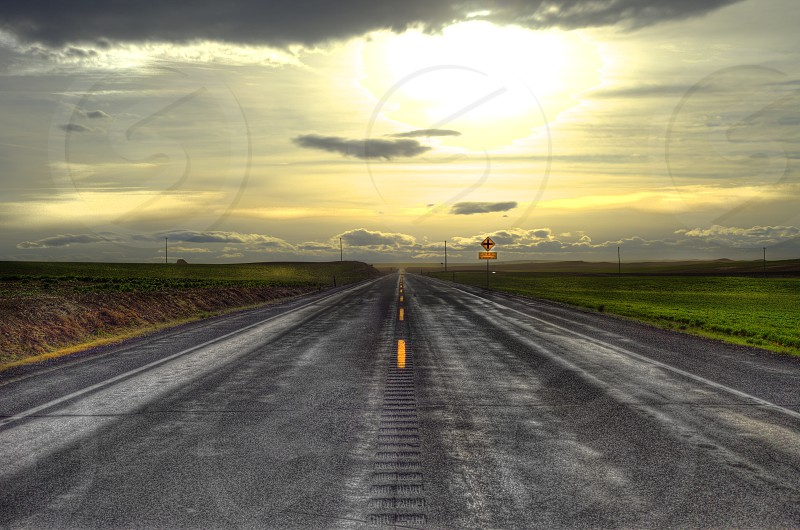 long highway perspective straight road pavement blacktop freeway desert photo