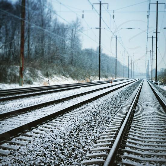 Snowy train tracks photo