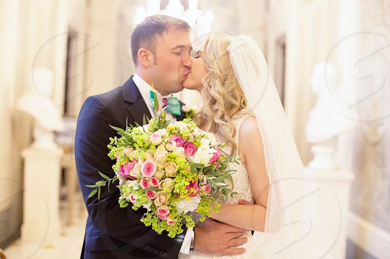kissing groom and bride in tilt shift lens photo