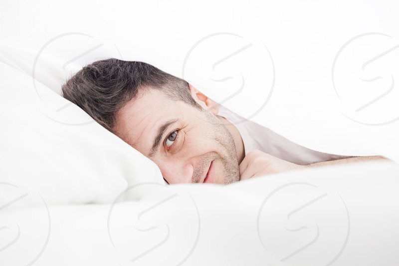 Lying in the sheets photo