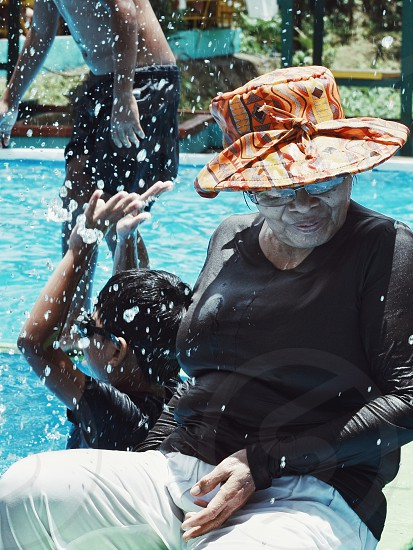 Old woman on a swimming pool photo