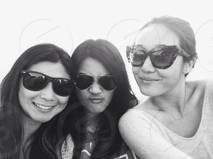 three women's black sunglasses photo