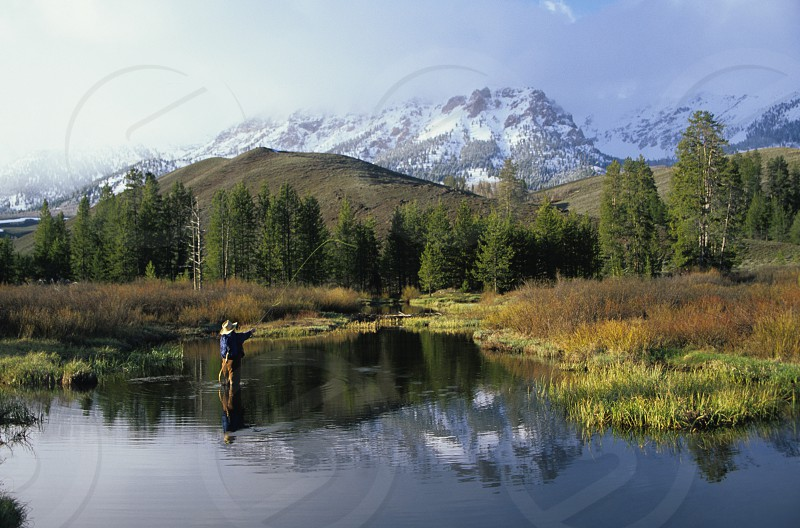 Fly fisherman and Boulder Mountains in Spring photo