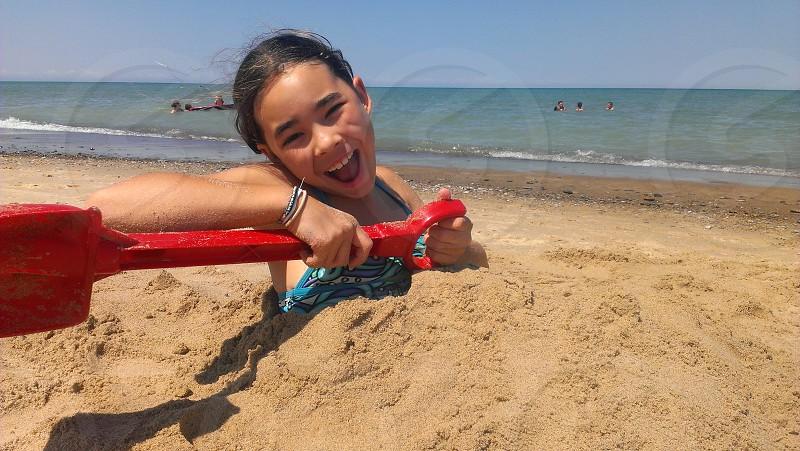 Buried in sand beach fun summer photo