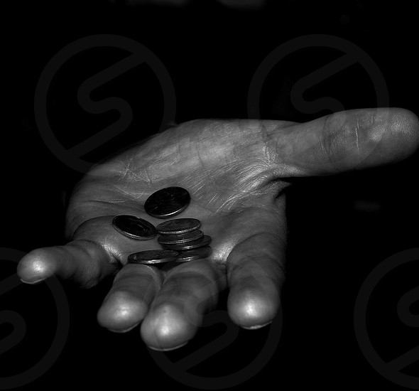 grayscale photo of person holding coins photo