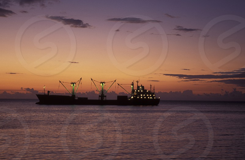 a ship in front of the city of Moutsamudu on the Island of Anjouan on the Comoros Ilands in the Indian Ocean in Africa.    photo