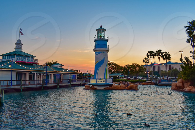 Orlando Florida. March 09 2019. Panoramic view of lighthouse on colorful sunset background at Seaworld in International Drive area. photo