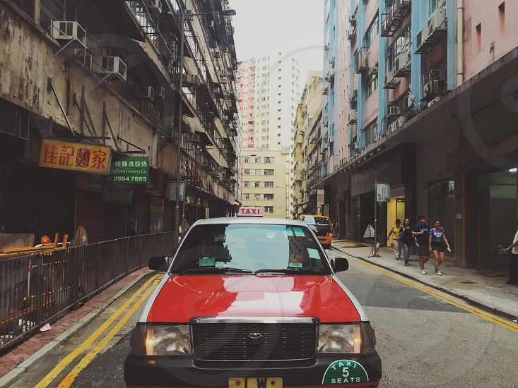 red taxi on road photo